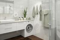 Le Verne : Salle de bains moderne composé d'une cabine de douche et d'un radiateur sèche-serviette