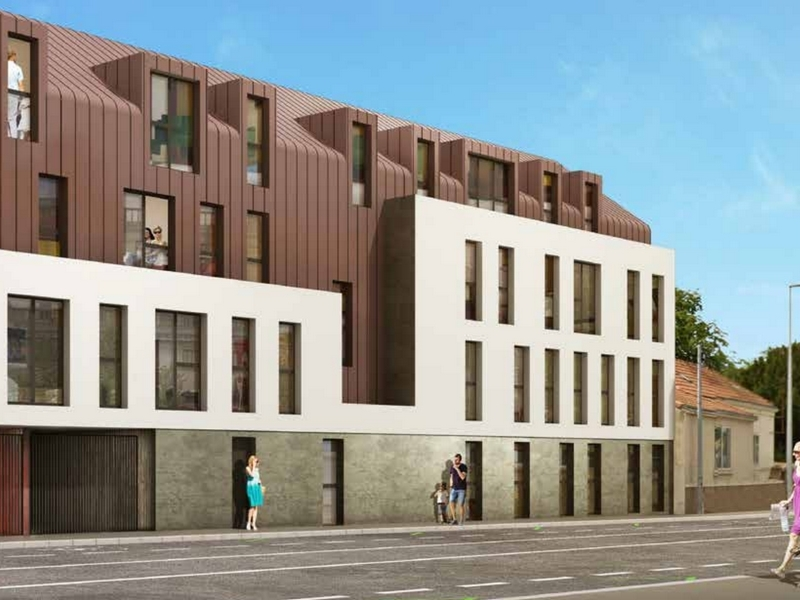 L'Amelia : Bâtiment contemporain et couvert d'un enduit brun
