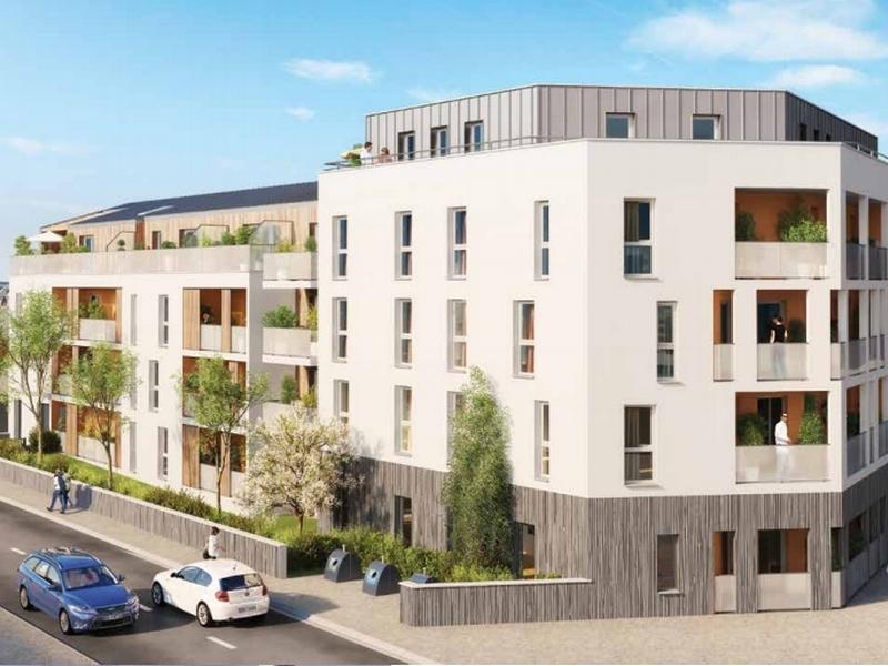 Patio Nantes : Bâtiment couvert d'un enduit blanc et donnant sur une rue paisible
