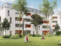 Patio Nantes : Bâtiment à l'apparence claire et entouré d'espaces de verdure