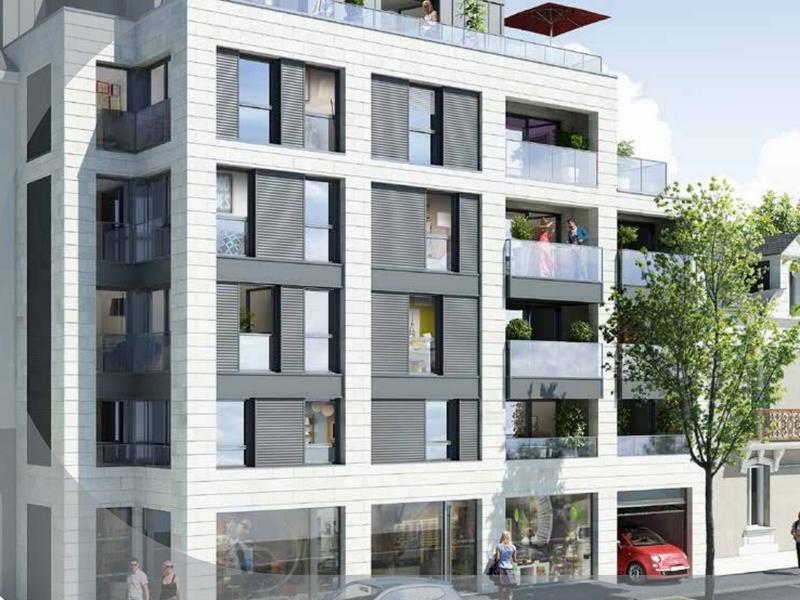 Immeuble avec balcon de couleur gris