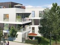 Villa Veluma : Immeuble recouvert d'un enduit blanc et gris
