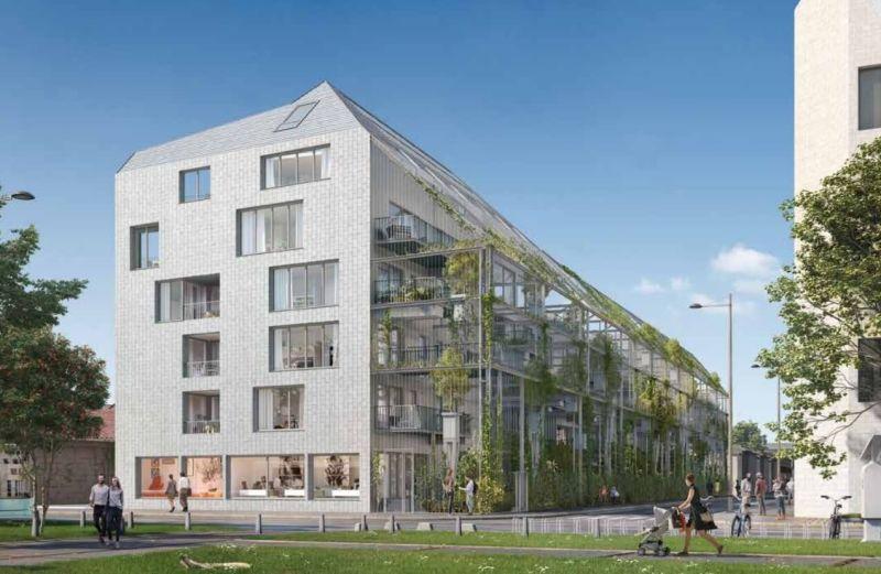 Ekko : Immeuble contemporain dont les façades sont couvertes de végétations tombantes