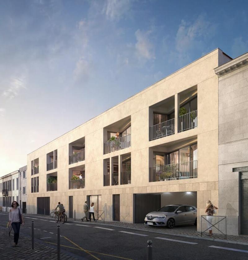 Carré Capucins : Immeuble contemporain couvert de pierres blondes