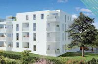 Os'Moz : Vu sur un bâtiment contemporain entouré de verdure